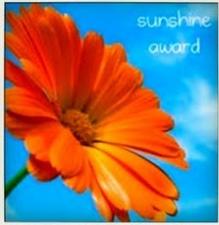 http://intothebardo.files.wordpress.com/2012/07/sunshine-award2.jpg