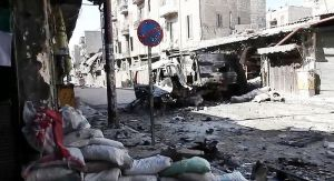 800px-Bombed_out_vehicles_Aleppo