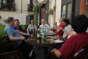 Poets gathered at tables in a cafe, Salerno, Italy, 100TPC World Conference