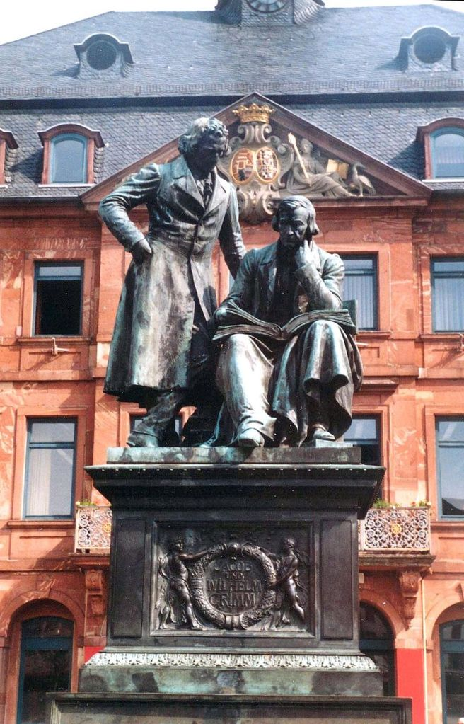 Monument to brothers Grimm on the market place in Hanau. (Hessen, Germany)