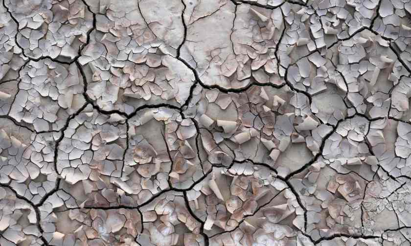 Cracked soil by a village in Iran abandoned by farmers because water reserves ran dry due to overuse. Photograph: Atta Kenare/AFP/Getty Images